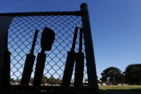 MELBOURNE, AUSTRALIA - NOVEMBER 29:  Cricketers bats rest against the fence near the Crib Point clubrooms in respect for Phillip Hughes before a 1st grade match between Crib Point v Rye at Crib Point Recreational Reserve on November 29, 2014 in Melbourne, Australia.  (Photo by Michael Dodge/Getty Images)