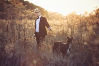 Young Attractive Man In Suit And Tie With A Greyhound Dog In Aut