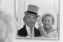 British crime writer and former jockey Dick Francis (1920 - 2010) has his hat adjusted by his wife Mary, on the day he received an OBE, London, 20th March 1984. (Photo by Mike Lawn/Express/Getty Images)