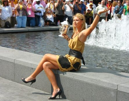 NEW YORK - SEPTEMBER 10 US Open 2006 champion Maria Sharapova holds US Open trophy in the front of the crowd after her win the ladies singles final on September 10, 2006 in New York
