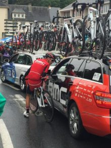 Richie Porte locked in conversation with the team car